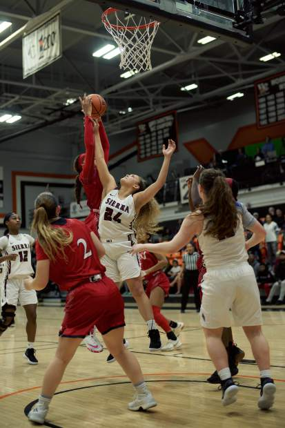 Aycee Willis, a 2017 Nevada Union graduate, battles for a rebound against Mt. San Jacinto College during the CCCAA Women's Championship Tournament semifinals. Willis would finish with three points, seven rebounds and four assists in the game. Sierra lost 71-59.