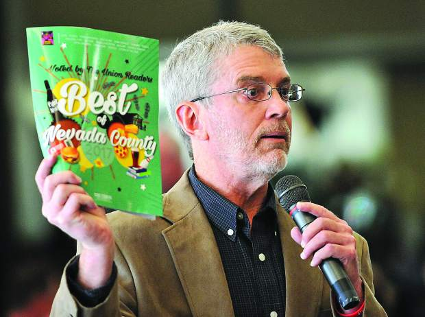 The Union publisher Don Rogers holds up the 2017 Best of Nevada County brochure with the lists of all winners, set to be available to the general public on Thursday March 29.