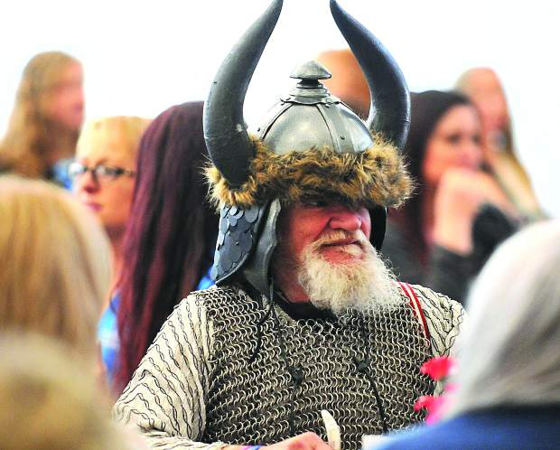 Tom Greene, dressed in chain maille and a viking hat, enjoys his meal and company at the Foothills Event Center during Wednesday's Best Of Nevada County luncheon. Greene, who volunteers with Hospice of the Foothills, wears a different costume each day to help cheer up the terminal hospice patients.