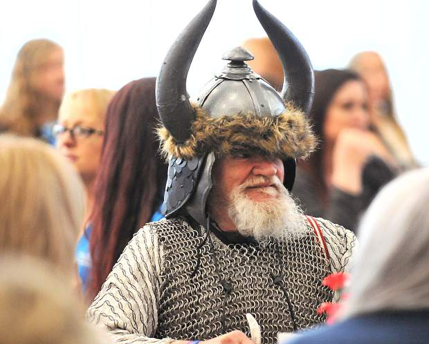 Tom Greene, dressed in chainmail and a viking hat, enjoys his meal and company at the Foothills Event Center during Wednesday's Best Of Nevada County luncheon. Greene, who volunteers with Hospice of the Foothills, wears a different costume each day to help cheer up the terminal hospice patients.