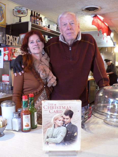 "Genevieve Crouzet and Kirk Valentine, owners of the Nevada City Classic Café, say there's no question the movie ""The Christmas Card"" has helped the restaurant's bottom line."