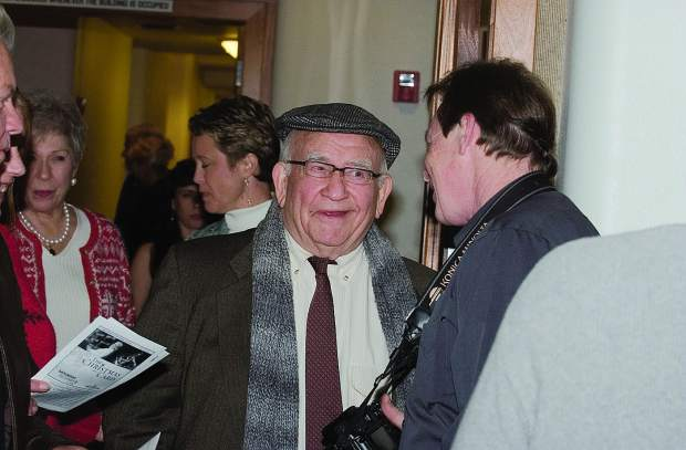 Former Nevada City council member David McKay, right, greets actor Ed Asner as he walks into the council chambers in City Hall in December 2006.
