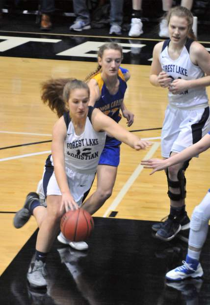 Forest Lake Christian sophomore Jessi Dreschler dribbles towards the basket during Friday's championship game.