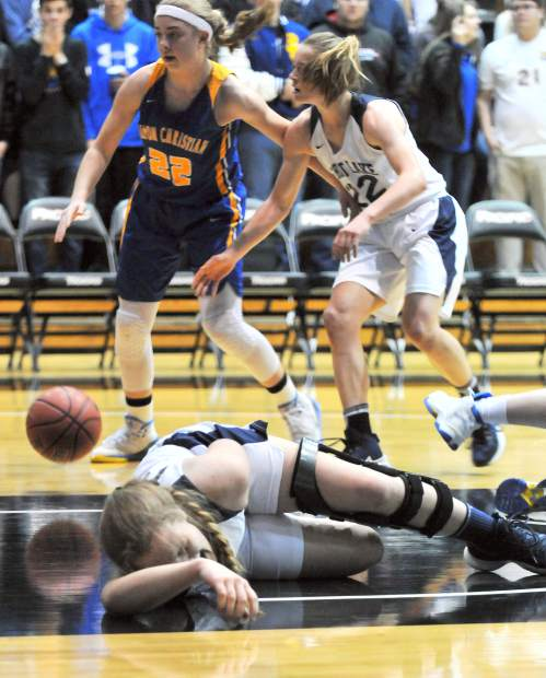 Forest Lake Christian's Johnna Dreschler hits the ground hard after diving for a loose ball.