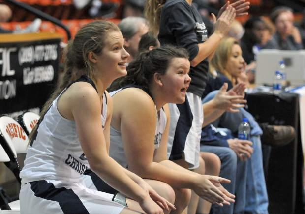 The Forest Lake Christian bench reacts after a Falcon basket.