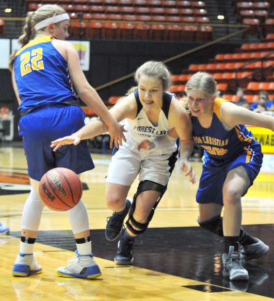 Johnna Dreschler chases the ball during Friday's championship game loss to Ripon Christian. Dreschler scored 14 points and pulled down 10 rebounds in the game.