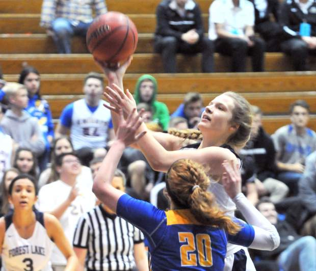 Johnna Dreschler attacks the basket during Friday's championship game loss to Ripon Christian. Dreschler scored 14 points and pulled down 10 rebounds in the game.