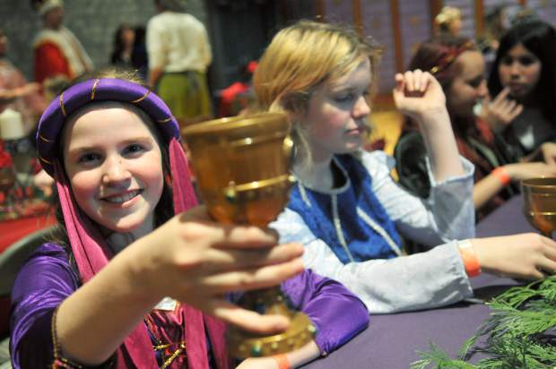 Emily Trujillo holds up her goblet for a refill of apple juice during Thursday's Medieval Feast activities.