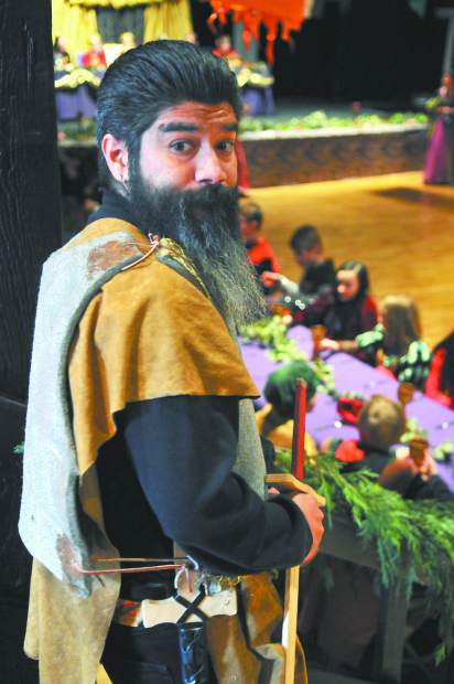 Seven Hills Middle School parent Marcelino Jardin is in perfect attire as he stands guard over the Medieval Feast Thursday at the Miners Foundry in Nevada City.
