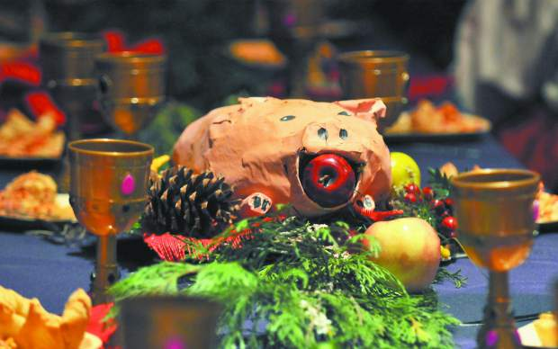 A papier-mâché pig sits on a table during the medieval feast festivities at the Miners Foundry Thursday. The
