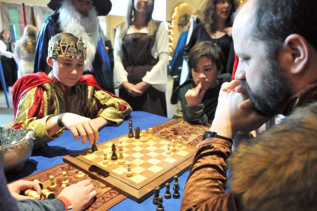 Dressed in royalty, King Steele Witchek, challenges Seven Hills Middle School teacher Paul Gross during the Tournament of Games portion of the Medieval Feast.