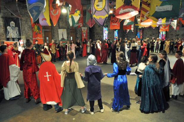 Students from different kingdoms gather around to take part in the Royal Dances portion of the Medieval Feast.