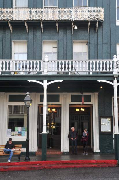 Folks leave the iconic National Exchange Hotel in Nevada City earlier in the year. The more than 150-year-old building is on the national registrar of historic places and is a lasting remembrance of California's gold rush. The building has been sold to new owners who plan to renovate the hotel.