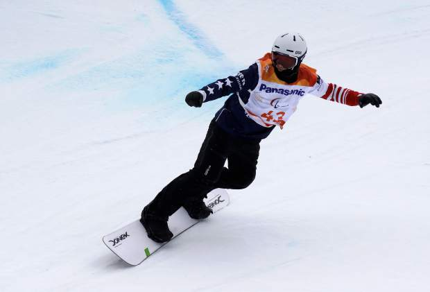 Silver medal winner Evan Strong of the United States competes in the men's snowboard banked slalom sb-ll2 at the 2018 Winter Paralympics in Jeongseon, South Korea, Friday, March 16, 2018. (AP Photo/Lee Jin-man)