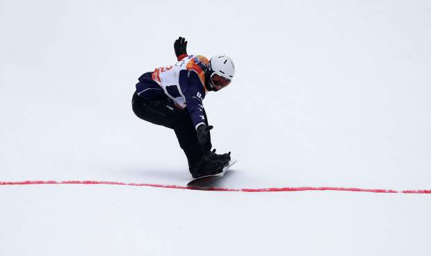 Silver medal winner Evan Strong of the United States crosses the finish line in the men's snowboard banked slalom sb-ll2 at the 2018 Winter Paralympics in Jeongseon, South Korea, Friday, March 16, 2018. (AP Photo/Lee Jin-man)