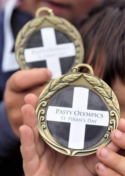 Children hold their medals received for competing in the pasty olympics.