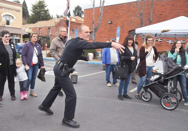 Grass Valley Chief of Police Alex Gammelgard shows off his pasty tossing form during Saturday's pasty olympics.