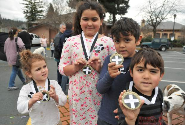 Solomon (from left), Layla, Dennis-Clark, and Gideon Geary hold up their St. Piran's day pasty olympics medals.