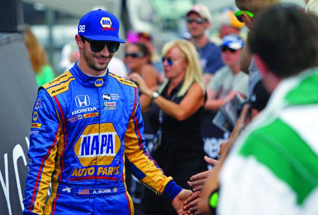 Alexander Rossi is seen during driver introductions for the IndyCar Honda Indy 200 auto race Sunday, July 30, 2017, at Mid-Ohio Sports Car Course in Lexington, Ohio.