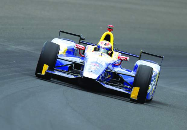 Alexander Rossi drives through the first turn during the running of the Indianapolis 500 auto race at Indianapolis Motor Speedway, Sunday, May 28, 2017, in Indianapolis.