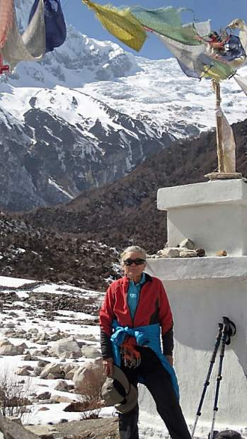 Annie Looby in 2014, stands at the shrine honoring those who died climbing Manaslu peak, a stop on the Manaslu circuit trek.