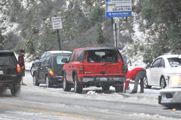 Spun out vehicles along Brunswick at Idaho-Maryland Rd. put on tire cables on the side of the roadway during the Friday evening commute.