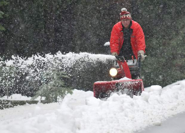 Cascade Shores resident Ron Breeden uses a snow blower to keep snow from piling up in front of his residence off of Pasquale Rd. Friday afternoon. Snow levels dropped to Grass Valley by Friday afternoon, causing multiple vehicle collisions and traffic snarls. Area residents will get a break from the winter weather Sunday and Monday when forecasters are calling for dry weather.