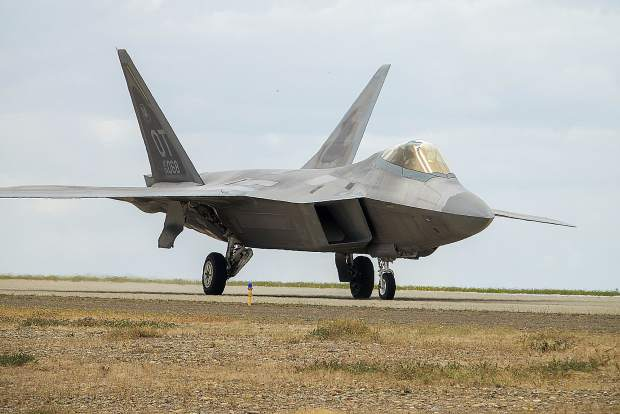 An F-22 Raptor rests at the ready on the taxi way Saturday at Beale Air Force Base's Air & Space Expo 2018.