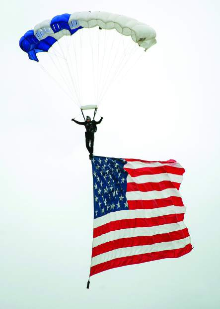 Photo by John Hart Beale Air Force Base's Beale Air & Space Expro 2018, Saturday at the base. There were static Displays of different types of planes, and the air show. The Air Force Wings of Blue Parachute Team from the Air Force Academy, Colorado Springs, Co with American flag durning the National Anthem.