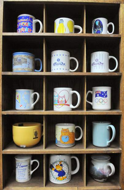 An intricate selection of coffee mugs sits on display at the newly renovated Bread and Roses thrift store.