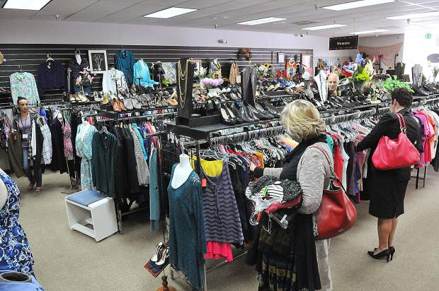 Shoppers look through the selection of clothing available at the newly renovated Bread and Roses Thrift & More store located next to Sierra Cinemas on Main Street.