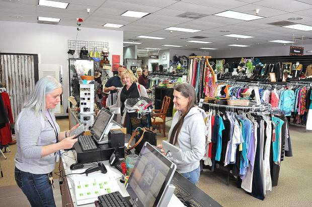 Folks line up in the expanded checkout area for customers at the recently renovated Bread and Roses Thrift & More store.