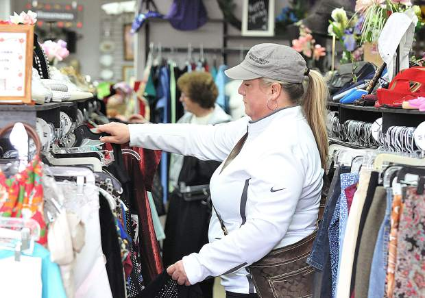 A shopper peruses through the selection of clothing available at the newly renovated Bread and Roses Thrift & More store located next to Sierra Cinemas off of Main Street.