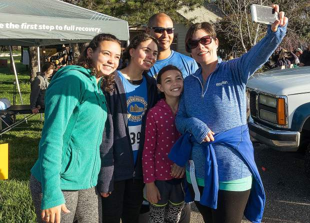 The Fuentes family -- Sierra (15), from left, Olivia (12), father Edwin, Sofi (8) and mother Amanda -- snaps a selfie Sunday at the 18th annual Daffodil Run 5K, 10K, and walk at Western Gatewy Parkin Penn Valley.