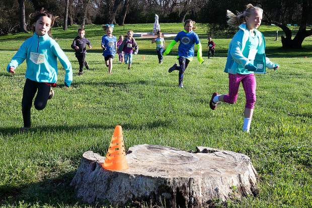 Youngsters take part in the Kids Run portion of the 18th annual Joanie Bumpus Daffodil 5K/10K in Penn Valley Sunday.
