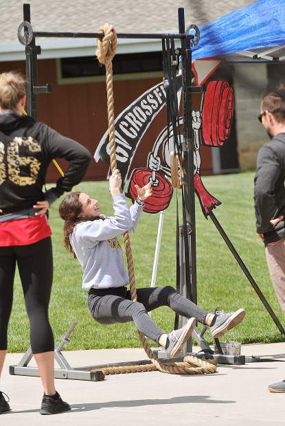 Sierra College student Emilia Melancon, climbs a rope offered by the Grass Valley Cross Fit booth.