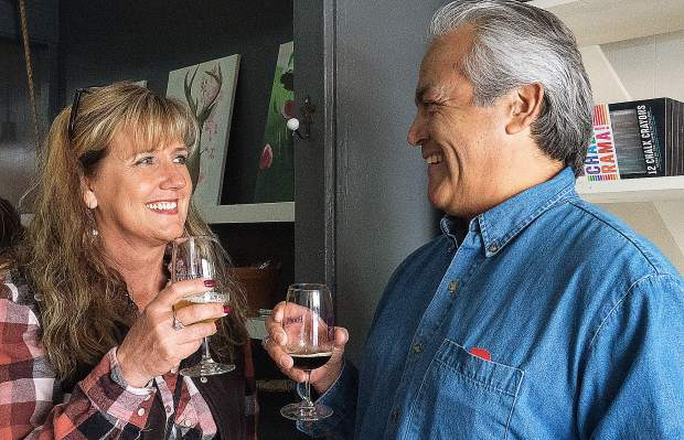 Lori and Antonino Herrera of Penn Valley enjoy a taste of beer from Ol'Republic Brewery of Nevada City during Saturday's Foothills Celebration.