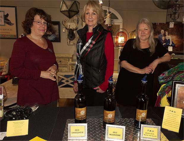 Betzi Hart, from left, Jacquie Rice, and Jackie Herring from the Bent Metal Winery share a taste of wines with Foothills Celebration attendees at Three Lillies Photography on Mill Street.