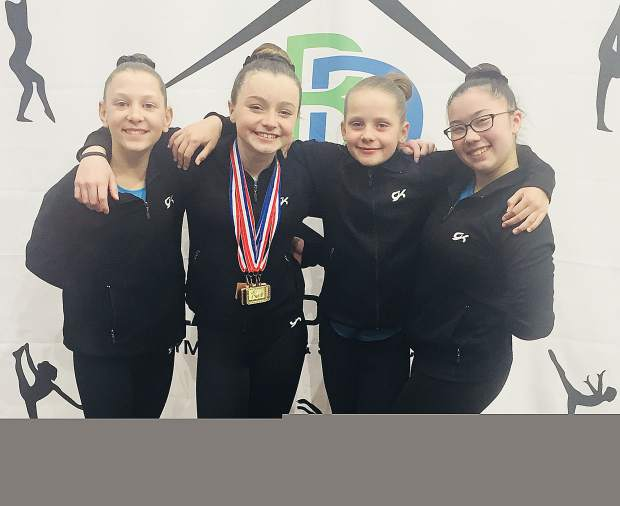 The girls at Auburn Gymnastics Center value each other's support. As a team they finish their season on a high note in Salt Lake City, Utah. From left is Gracie Hamilton, Ana Hamilton, Emma Allmon and Midori Ogino.