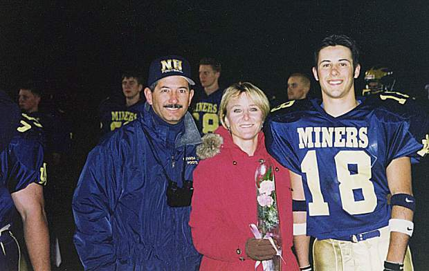 Mike Bratton is being inducted into the Nevada Union Athletics Hall of Fame April 28. Bratton is pictured here with his son Michael and wife Robin.