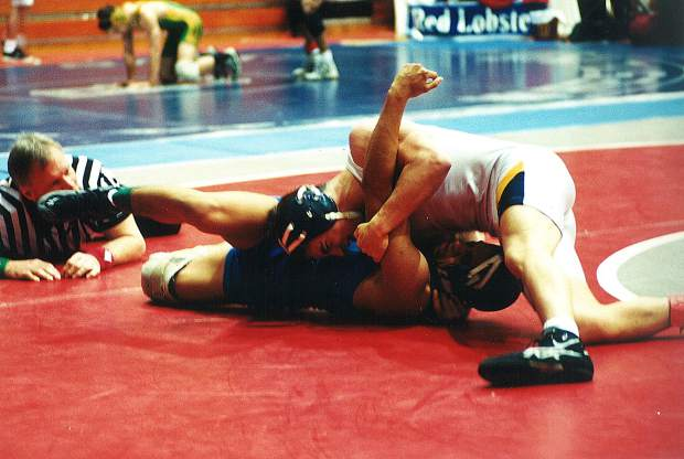 Paul Gross, top, was a standout wrestler for Nevada Union in the late 1990s, winning individual Sac-Joaquin Section championships in 1998 and 1999, qualifying for the State Championships four times and earning top-four finishes twice, and helping his team to four straight league titles. In addition to winning the 125-pound section title in 1999, Gross placed second at the state championships and was named a High School All-American. Gross will be inducted into the Nevada Union Athletics Hall of Fame April 28.