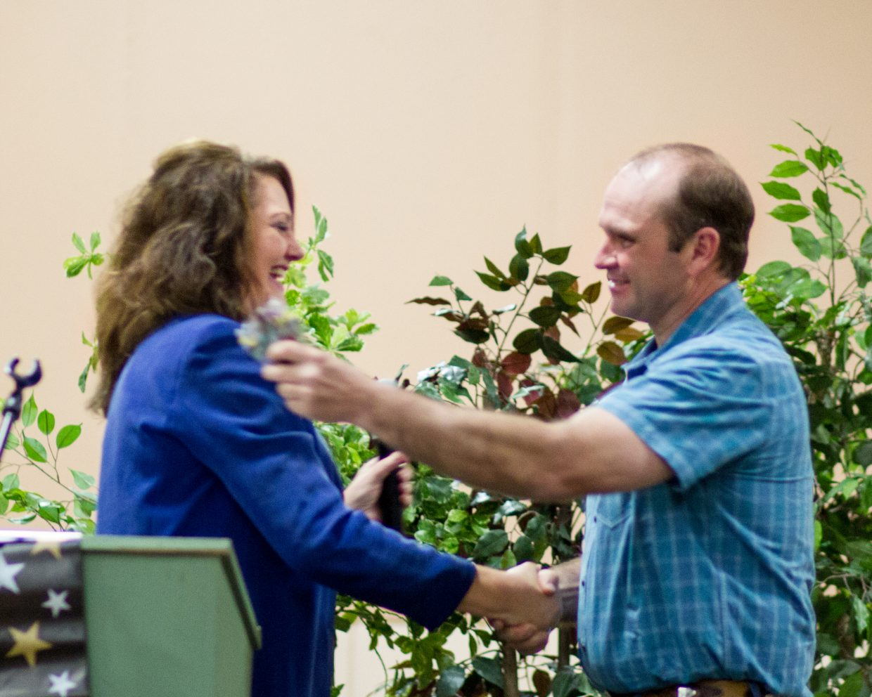 Mary Anne honors Hansen Brothers Enterprises Business of the Year Nominee at the recent Rotary Community Awards Ceremony