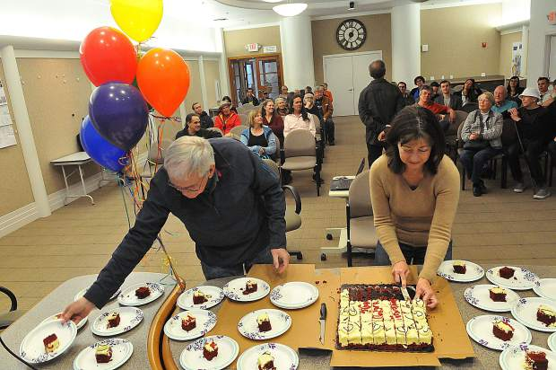 Nevada City staff cut pieces of cake for those in attendance of Thursday's birthday bash.