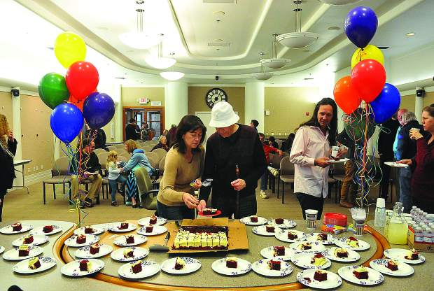 Cake is served Thursday evening in the Nevada City council chambers at City Hall, to celebrate the birthday of the gold rush city that turned 162 years old.