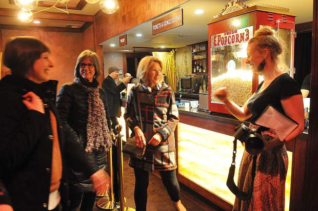 Theater patrons reunite as they tour the new Onyx Theatre, formerly the Magic Theatre, in Nevada City during the venue's grand re-opening Thursday. It is now a 21-and-over only establishment and serves food and alcohol.