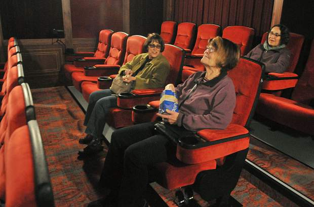 Folks test the reclining seats of the new Onyx Theatre, now showing regular screenings at the site of the former Magic Theatre off of Argall Way in Nevada City.