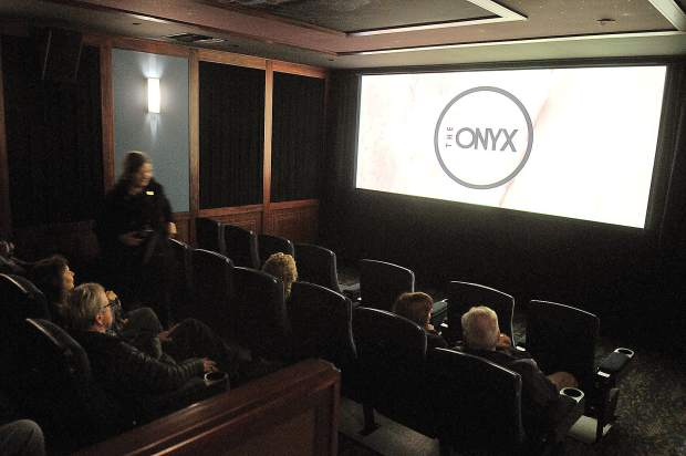 Folks get a tour of the new Onyx Theatre during Thursday's grand re-opening.