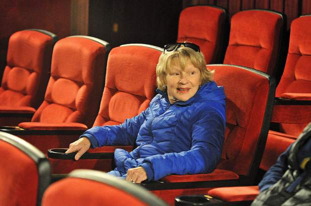 Nevada City's Laurie Dayton smiles as she tests out the new plush seats at the Onyx Theatre, formerly known as the Magic Theatre, in Nevada City during the grand re-opening Thursday. Regular showings began Friday with tickets available at the box office at 107 Argall Way, or online at www.theonyxtheatre.com.