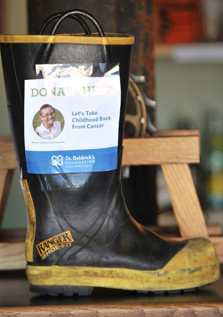 Firefighter boots sit on the counters of Ol' Republic Brewery during Saturday's Brave the Shave event to end childhood cancer. About $13,000 was raised during the event from donations.