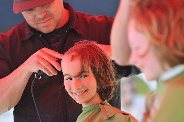 Walter Mainguth, 7, smiles at his friend Louie Forrette, 8, took time to get their heads shaved during the Brave the Shave St. Baldricks event to help end childhood cancer. The event was Saturday in front of the ol' Republic Brewery. Around $13,000 was raised with 41 participating.